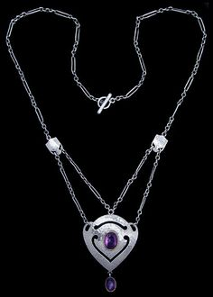 MURRLE BENNETT & Co. (1896-1914)   An Arts & Crafts hammered silver necklace set with a central amethyst and an amethyst drop, both in golden settings. Two silver spacers to the original chain.  Anglo/German c.1900. Marks for MB & Co. and 950. (Necklace case)  Size: Length of pendant 4.1 cm. Width 2.9 cm. Approx. necklace length 43.2 cm.  Lit.: Art Nouveau Jewelry. Vivienne Becker. Liberty Style. Academy Editions.