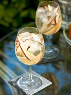 Winter Sangria a seasonal take on the Spanish classic made with champagne, sliced apples and pears, and spiced with cloves and nutmeg.