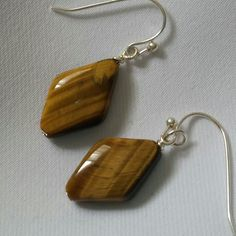 New Tiger's eye  gemstone earrings. Beautiful natural tiger's eye gemstone earrings with SS hook. Jewelry Earrings