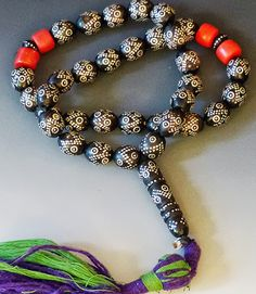 Beautiful strand of Black Coral from Yemen. Yemen silver smiths have a long tradition of nailing tiny silver nails into black coral beads, and these are excelle