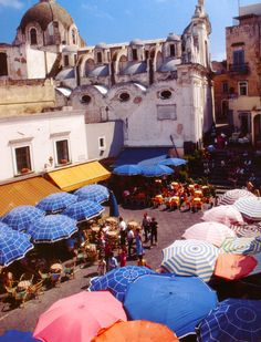 Capri: La piazzetta in the 70's. Love the different patterned parasols they used back then.
