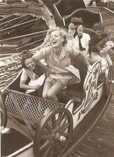 Kurt Hutton - classic photograph of two young women on the merry-go-round at Southend Fair, England