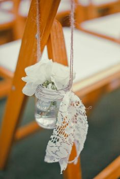 mason jars on shepherd's hooks to line the walk from the church to the reception. Alternating floating candles and simple flowers.