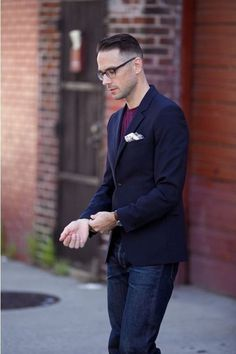 Shop this look on Lookastic:  http://lookastic.com/men/looks/navy-blazer-and-white-pocket-square-and-purple-crew-neck-t-shirt-and-navy-jeans/246  — Navy Blazer  — White Pocket Square  — Purple Crew-neck T-shirt  — Navy Jeans