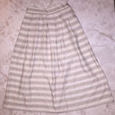 Beautiful cream and beige striped vintage skirt. The perfect neutral vintage skirt. Hits mid calf and sits high waisted. Wear with a white tank top or cropped sweater, so classic and sweet! Vintage Skirts Maxi