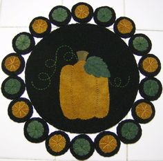 Wool Pumpkin Penny Rug by QuiltgirlsCreations on Etsy, $25.00