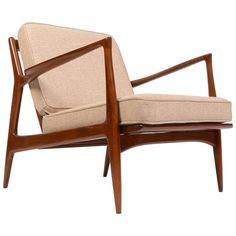 Danish Lounge Chair by Ib Kofod-Larsen for Selig, Restored   From a unique collection of antique and modern lounge chairs at https://www.1stdibs.com/furniture/seating/lounge-chairs/