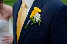 Navy and yellow suit with the yellow cala lilly (or a daisy) | wedding