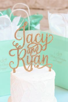 Your wedding cake will sparkle, with this personalized names cake topper. Choose from assorted colors of glitter for a touch of glitz and glam. Such a perfect way to add a personal touch to your cake, and it makes a great keepsakes after your special day too.