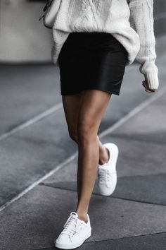 white puma sneakers, leather skirt, oversized sweater