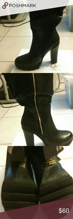 GORGEOUS BLACK BOOTS. One side has black zipper .on one side of the boots it's black leather no design and on the same side other half has a design.  They come just below the knee and are 4.5 inches on heel. So pretty. Love these boots they were a gift never wore didn't fit. Size 8.5 other side doesn't zip but has a gold zipper for looks. DB DK Shoes Heeled Boots