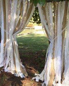 Wedding garland made of various lace strips & burlap. Torn and rag tied - edges are meant to fray.  Listed garland is: 5ft wide X varying in 5ft to 6ft long pieces....($20.00 per additional foot in width) Perfect for accenting ceremony stage, cake table, doorways, drape between trees or use as your photo booth background. Other garland uses: Special Events - bridal shower, baby shower, birthday parties, graduations, retirement parties, engagement photos. Home Decor - Window Treatments, C...