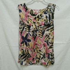Banana Republic sleeveless blouse size 14 Silky polyester sleeveless blouse in abstract floral.  Excellent condition.  Nice pleating at neckline, side zip for great fit (see pic)  Looks beautiful with grey suiting, also black.  Versatile piece. Banana Republic Tops Blouses
