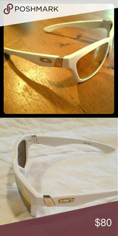 White Oakley Women's Sunglasses White frames with gold color oakley logo and gold tinted lenses. Gently used, only worn a few times. Oakley Accessories Sunglasses