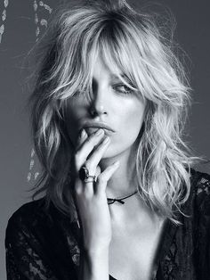 A middle parted grown out fringe and bed head waves - to achieve this try tonging large sections before you go to bed