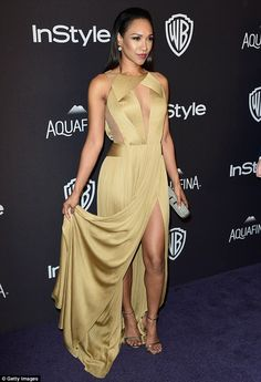 Golden girl: The 27-year-old actress looked fantastic in a sleeveless gold dress with a thigh-high split