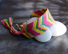 This lovely 1 wide friendship bracelet is handmade with embroidery floss and of course love. Comes with a hand stamped muslin bag. Owl Bracelet, Bracelet Crafts, Chevron Friendship Bracelets, Craft Kits, Craft Ideas, Muslin Bags, Colorful Bracelets, Spring Colors, Hand Stamped