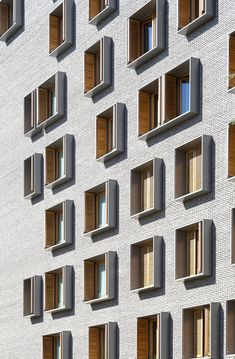 """ French architect Michel Guthmann is the visionary behind this Paris housing project . ""The choice of materials and colours, the rhythm of openings in the facades and the relations the housing maintains with the exterior and the nature of the public..."