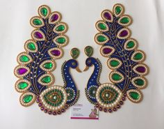 Beautiful peacock handmade Kundan Rangolis that you can arrange just the way you like..Decorate your home in the most unique way for Festivals , pooja, traditional events and weddings. You may arrange them in many ways, handmade jeweled decals