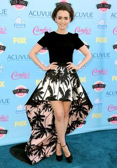 Lily Collins in a Fausto Puglisi skirt, and Houghton shirt with Brian Atwood shoes.