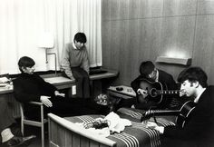 October 1963, Stockholm, The Beatles, l-r, Ringo Starr, Paul McCartney, George Harrison and John Lennon relaxing and trying some new songs in their hotel suite during their 8 day visit to Sweden.