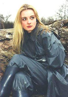 Very pretty lady in nylon rainsuit