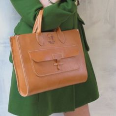 """ONLY ONE AVAILABLE- Hand oiled, saddle stitched 8-9 oz vegetable tanned leather computer/meeting bag Single piece construction Fits a 13"""" Macbook Pro and Macbook Air perfectly 15""""W 10.5""""H 2.5""""D Handle"""