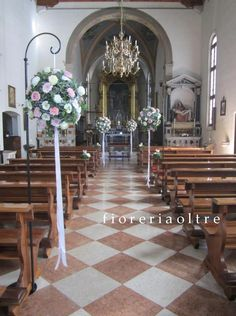 Fioreria Oltre/ Wedding ceremony/ Church wedding flowers/ Flower balls/ Roses, gerbera daisies, carnations, ivy Church Wedding Flowers, Wedding Bouquets, Wedding Ceremony, Gerbera Daisies, Carnations, Altar, Church Aisle, Flower Decorations, Table Decorations