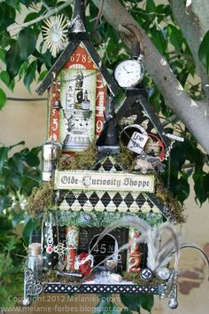 Graphic 45 papers used on old birdhouse.  Would like to do a haunted birdhouse like this