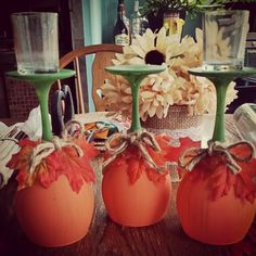 DIY Fall pumpkin wine glass candle holders   Just used dollar store wine glasses, acrylic paint and hot glue gun! Super easy and inexpensive