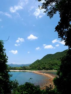 Playing peekaboo with the tombolo on Sharp Island, Sai Kung, Hong Kong - what a stunning view!