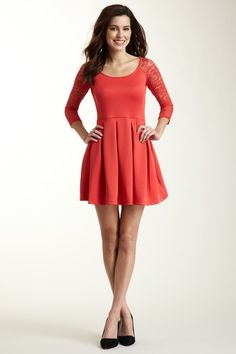 Soprano Lace Sleeve Pleated Skirt Dress on HauteLook. I would wear this as a tunic with skinny jeans, tights or leggings. It's too short to be tasteful worn by itself.