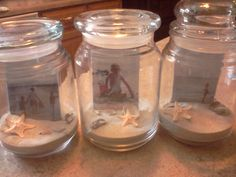 Sand + a photo from vacation + a recycled candle jar = a memory jar for kids