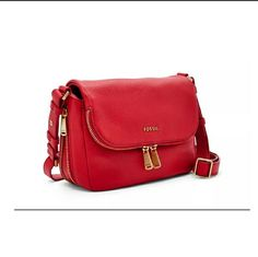Fossil Preston Flap Cross Body Handbags Real Red This bag is made from leather and features a small shape with a zip around bottom detail that allows you to expand the overall size of the bag. The small main compartment features a flap top with a secure snap closure and a fully lined interior that includes a back wall zipper pocket and a front slip pocket. A zipper pocket around the edge of the flap offer added storage for small items that you need to keep within easy reach. This bag is big…