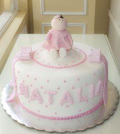 Hermoso pastel en tono rosa para el bautizo de la nena!