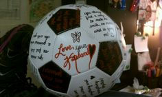 Creative idea for soccer player present.. taking a blank soccer ball and writing creative or thoughtful things on each section. :)