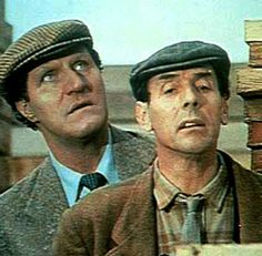 Tommy Cooper (left) and Eric Sykes (right) starred in the 1967 comedy short film 'The Plank' which also featured a host of other household faces of the era. Unlikely as it sounds, the slapstick running joke about two workmen fetching a plank to complete a flooring job was both hugely funny and very popular. Interestingly, in 1967, it seems that jobbing joiners laying timber floors on building sites went to work wearing tweed jackets and ties !