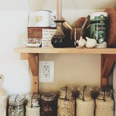 Love all the various sizes of mason jars. Makes the kitchen more organized.
