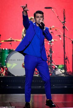 Party starter: Joe Jonas took to the stage once again with his brothers Nick and Kevin on Friday night, as the Jonas Brothers continued their tour in Toronto, Canada Nick Jonas Sin Camisa, Electric Blue Suit, Jonas Brothers, 3 Brothers, Francisco Lachowski, Kellan Lutz, Elizabeth Gillies, Joe Jonas, Big Sean