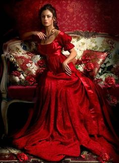 Red empire gown with sweet puffed sleeves