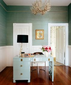 green grasscloth, gold antlers, power blue lacquer,  black lamp shade.