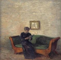Interior with a Lady seated on a Birchtree sofa reading a book (1903). Vilhelm Hammershøi (Danish, 1864-1916).