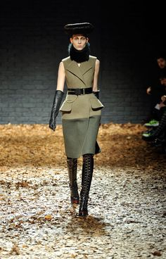Military Mode... love the cut of the dress and the boots- Alexander McQueen