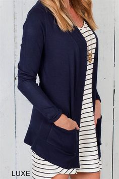 Introducing our top selling cardigan! This soft cardigan is the perfect piece for your everyday wardrobe. Versatile in look and comfortable in style, this cardigan is easy to pair with leggings, jeans, or dresses.
