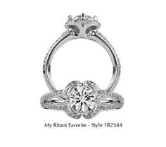 Engagement ring by Ritani.  Looks like a clover!
