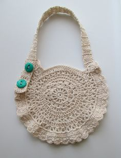 This is a baby bib, but what a great looking crocheted purse it would make also!