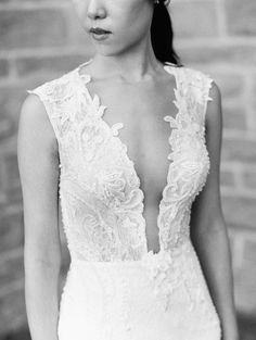 really delicate lace detail on this deep front wedding gown.