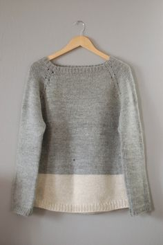 top down raglan knit with white trim love it: