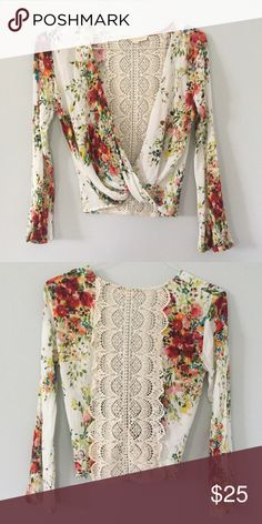 Floral Wrap Top with Lace Back Super cute and only worn once. Bought from a boutique store. Love Stitch Tops Blouses