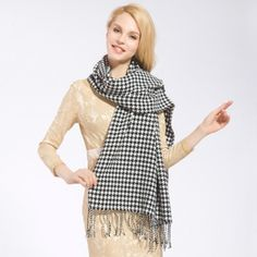 http://www.buyhathats.com/black-and-white-houndstooth-scarf-women-autumn-tassel-plaid-shawl.html